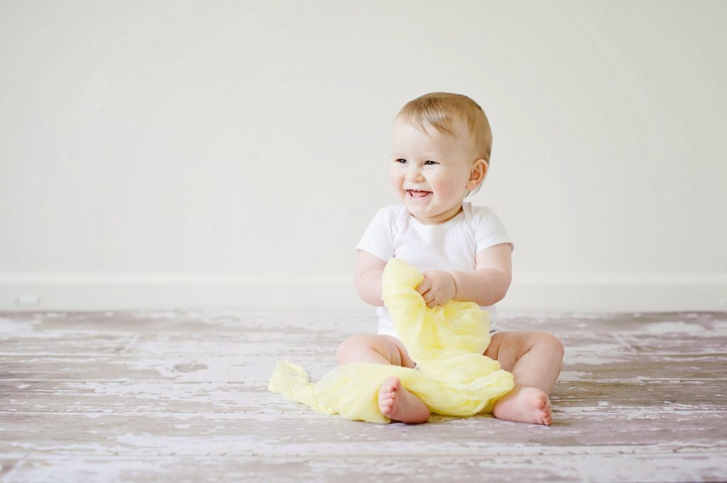 baby in yellow sitting