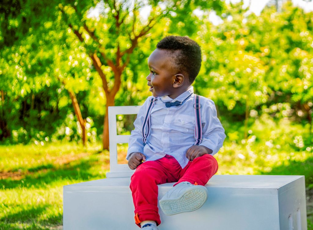 child in red pants sitting